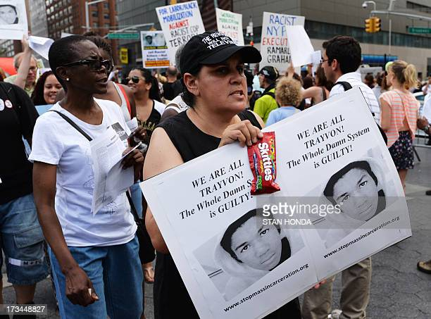A woman holds a pack of Skittles and a sign during a demonstration in New York on July 14 2013 Protests were held one day after a US jury found...