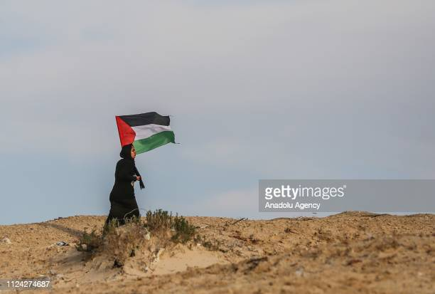 A woman holds a Palestinian flag within the maritime protests against Israels ongoing blockade of Gaza in Beit Lahia Gaza on February 12 2019