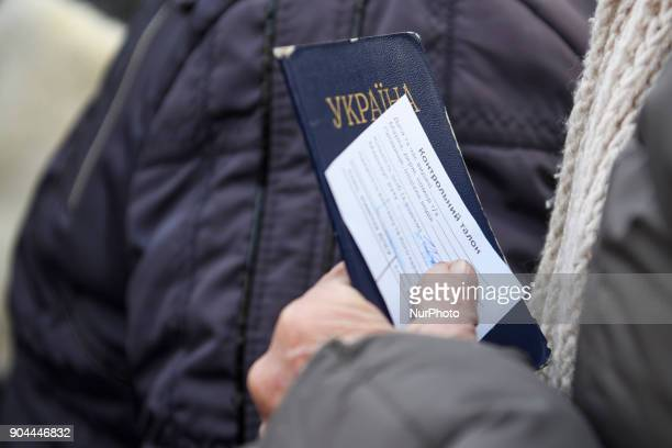 woman holds a Passport and control ticket Checkpoint quotHnutovequot in Hnutove village near Mariupol Ukraine on 12 January 2018