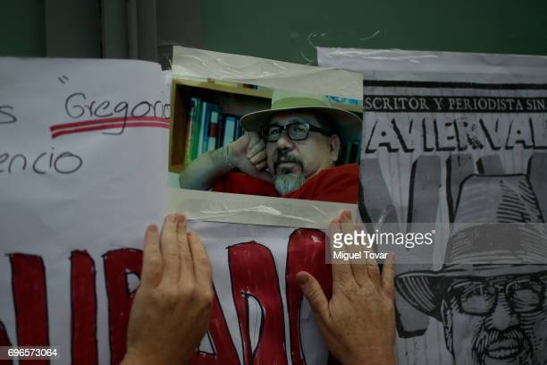 A woman holds a photo of the murdered journalist Javier Valdez during a demonstration to end violence against journalists in Mexico outside the...