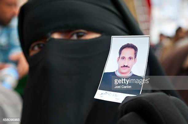 victim of revolution - nikab stock pictures, royalty-free photos & images