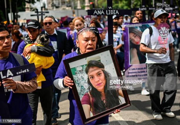 A woman holds a picture of a murdered relative during a protest against femicides in Mexico City on November 3 2019