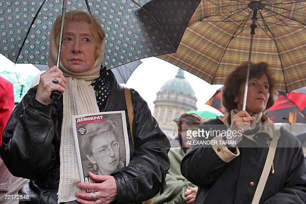 A woman holds a picture of a slain Russian journalist Anna Politkovskaya during a rally marking the ninth day after her killing in StPetersburg 15...