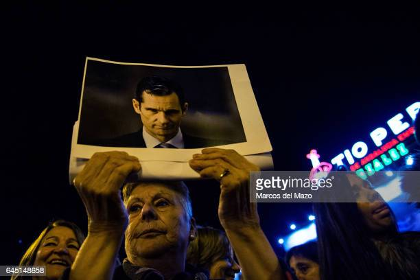A woman holds a picture of I Urdangarin during a protest against corruption case Noos I Urdangarin has been sentenced with jail for six years and...