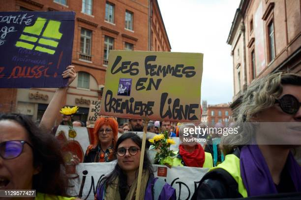 A woman holds a placar dreading 'Woemen on the first line' For the Act 17 several thousands of protesters called 'Gilets jaunes' demonstrated in...
