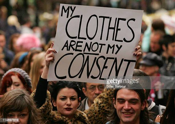 A woman holds a placard aloft during a Slutwalk march for the right of women to wear what they want without harassment on May 28 2011 in Melbourne...