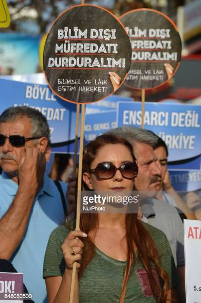 A woman holds a placard as people protest against the Turkish government's new education policies in Ankara Turkey on September 16 2017 The Turkish...