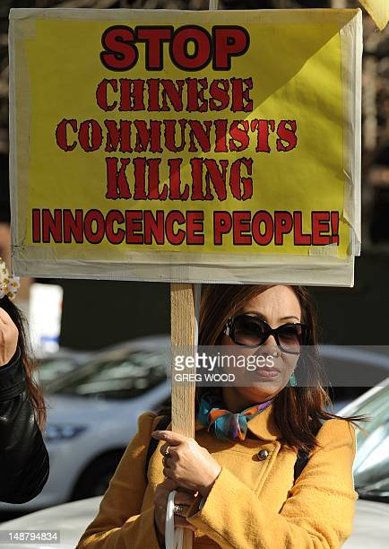 Woman holds a placard as practitioners of spiritual movement Falungong gather at Sydney's Town Hall Square on July 20, 2012. The group intends to...