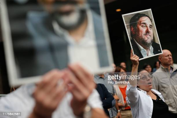 Woman holds a placard depecting a picture of jailed Catalan separatist leader Oriol Junqueras in Barcelona on October 14 after Spain's Supreme Court...