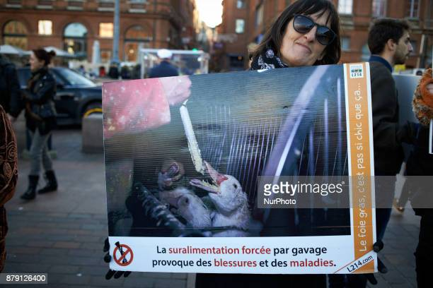 A woman holds a placard depicting gooses forcefed and reading 'forcefeeding causes sickness and wounds' The L214 association did a 'speeddating'...