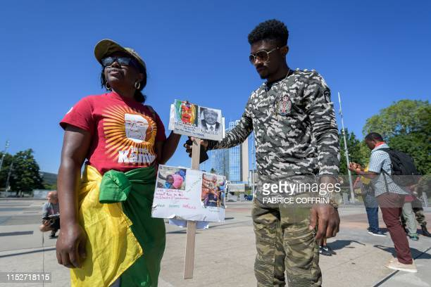 Woman holds a placard during a demonstration with others Cameroonian' nationals living from different European country, against the presence of...