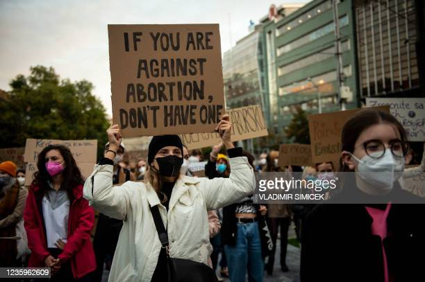 Woman holds a placard during a protest against a new legislation relating abortions in Bratislava, Slovakia on October 18, 2021.