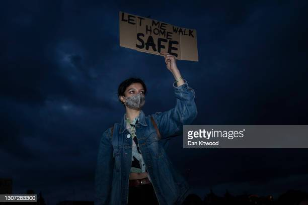 Woman holds a placard during a protest against the The Police, Crime, Sentencing and Courts Bill and criticising the actions of the police at...