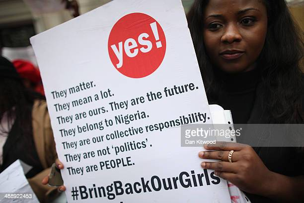 A woman holds a placard during a protest calling for the release of 276 abducted Nigerian schoolgirls outside Nigeria House on May 9 2014 in London...