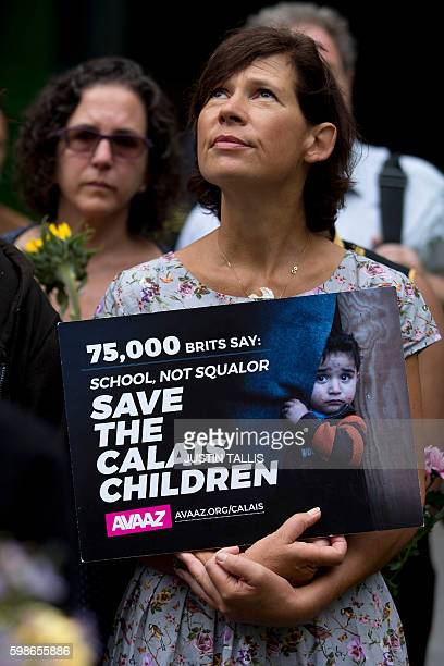 A woman holds a placard during a rally held outside the Home Office in London on September 2 where campaigners delivered a petition signed by 75000...