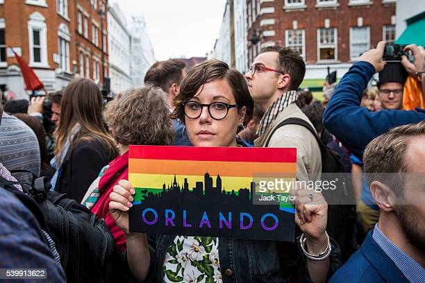 A woman holds a placard during a vigil for the victims of the Orlando nightclub shooting outside the Admiral Duncan pub on Old Compton Street Soho on...