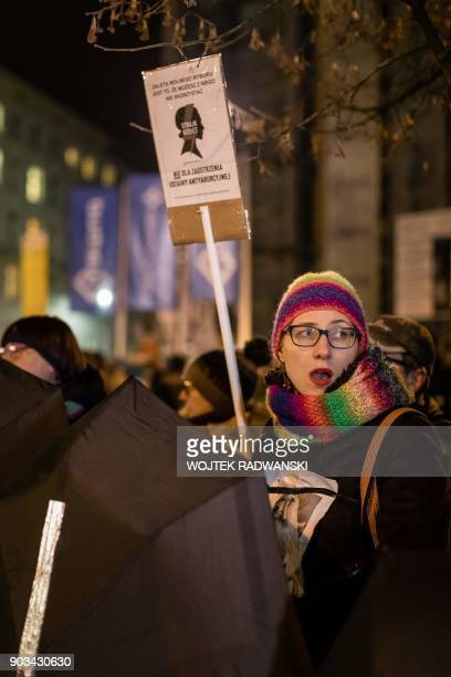 A woman holds a placard during an antigovernment and proabortion demonstration on January 10 2018 outside the Parliament in Warsaw Poland's abortion...