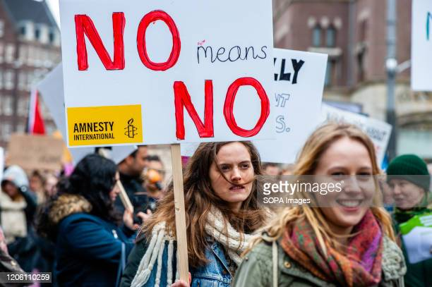 A woman holds a placard during the demonstration During the International Women's day thousands of women gathered at the Dam Square in the center of...