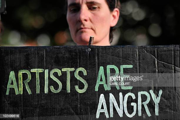 A woman holds a placard outside the Tate Britain after protesters belonging to a group of artists calling themselves 'The Good Crude Britannia' who...