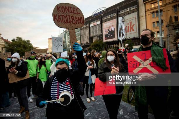 Woman holds a placard reading 'End of Catholiban!' as she attends a protest against a new legislation relating abortions in Bratislava, Slovakia on...