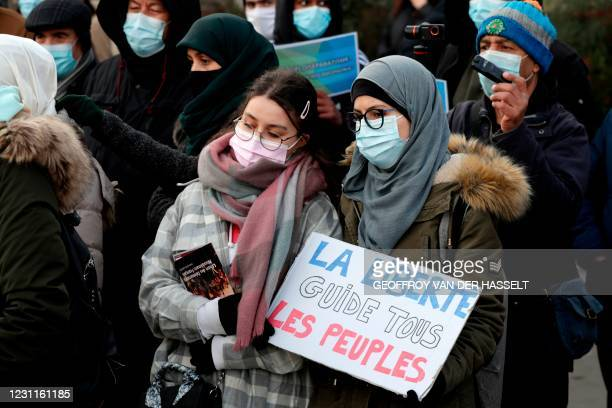 """Woman holds a placard reading """"Freedom leads all the people"""" as protesters demonstrate against a bill dubbed as """"anti-separatism"""", in Paris on..."""