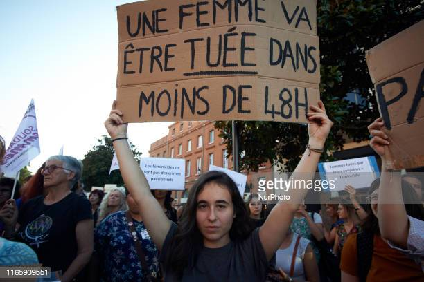 A woman holds a placard reading 'In the next 48 hours a woman will be killed' As Edouard Philippe French Prime Minister launches a consultation...
