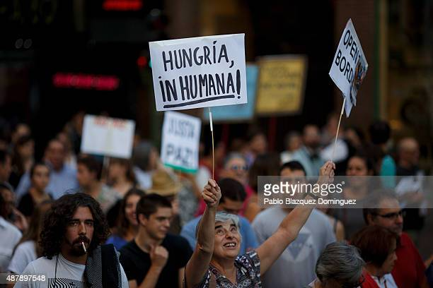 A woman holds a placard reading 'Inhuman Hungary' as she takes part in a demonstration to show solidarity and support for refugees on September 12...