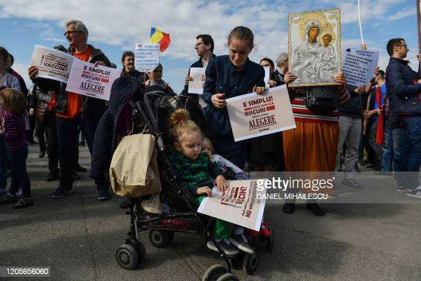 A woman holds a placard reading Is that simple If there is a risk I want a choice during a demonstration against a draft law to be adopted by the...