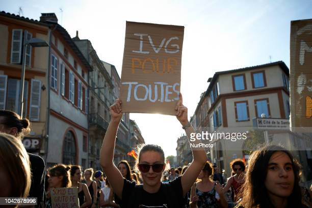 A woman holds a placard reading 'IVG for all' Women and men took to the streets of Toulouse for the International Safe Abortion Day They demonstrated...