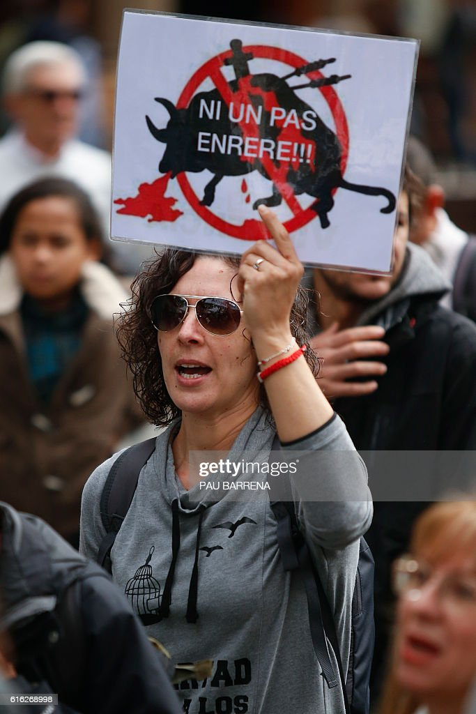 A woman holds a placard reading 'Not even a step back' during a pro-animal protest against the recent Spain's Constitutional Court cancellation of a ban on bullfighting in Catalonia, in Barcelona on October 22, 2016. Spain's Constitutional Court on October 20, 2016 cancelled a ban on bullfighting in the region of Catalonia, in what is likely to exacerbate tensions between animal activists and fans of the centuries-old tradition. BARRENA