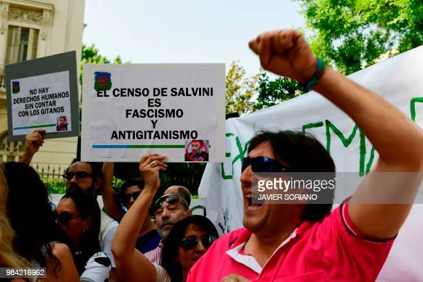 A woman holds a placard reading Salvini's census is illegal and antigipsy during a demonstration called by the Fundacion Secretariado Gitano a...