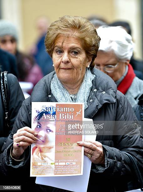 """Woman holds a placard reading """"Save Asia Bibi"""" during a demonstration in front of the Italian Parliament in central Rome on January 26, 2011 against..."""