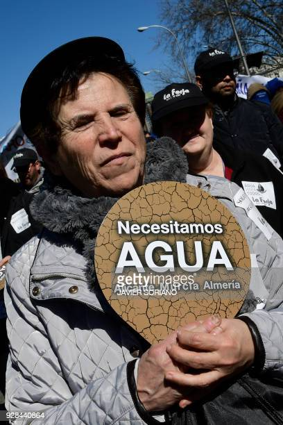 A woman holds a placard reading We need water in Alicante Murcia and Almeria during a demonstration by farmers from southern Spain to demand...