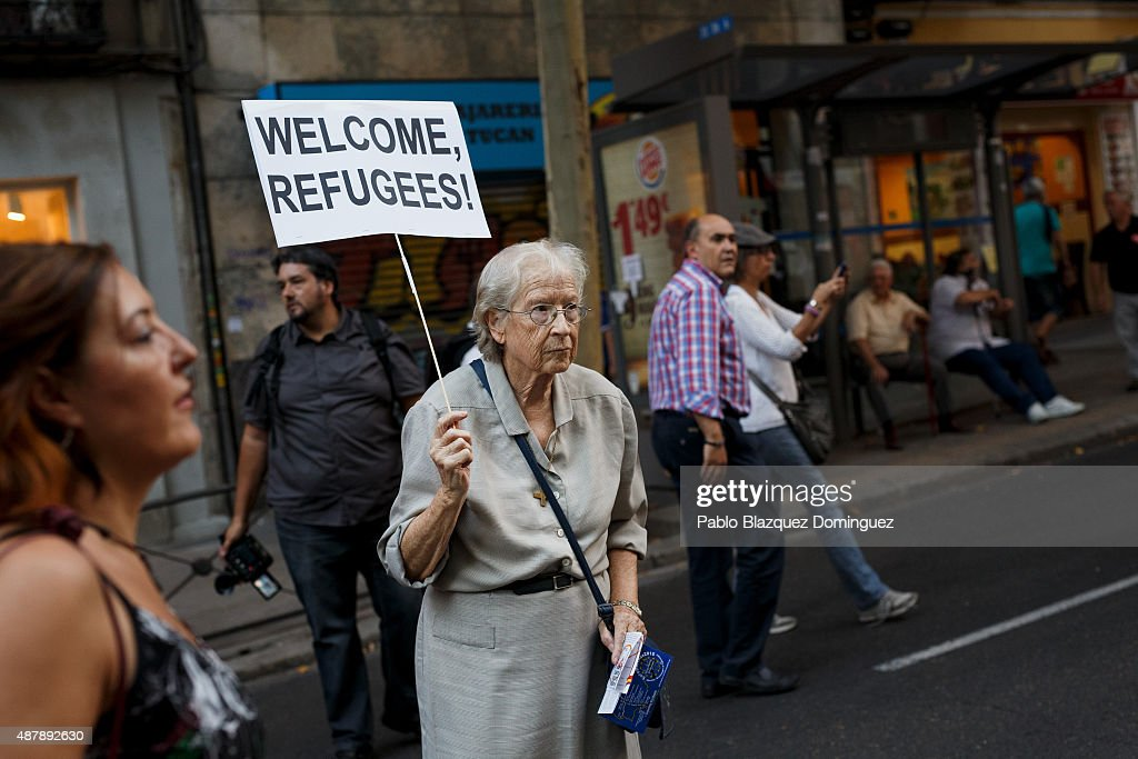 A woman holds a placard reading 'Welcome refugees!' as she takes part in a demonstration to show solidarity and support for refugees on September 12, 2015 in Madrid, Spain. Several cities across Spain have called for demonstrations under the slogan 'Welcome refugees. For a more responsible European policy'. Europe is facing the region's largest crisis of migrants and refugees since World War II. Spain would have to take nearly 15,000 refugees under a new European Union plan to relocate 120,000 refugees. Many Spanish cities and citizens took the lead on offering their support to refugees.