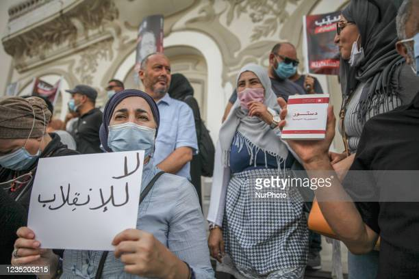 Woman holds a placard that reads in Arabic no to the coup, during a demonstration held in Tunis, Tunisia, on September 11 to call for the release of...