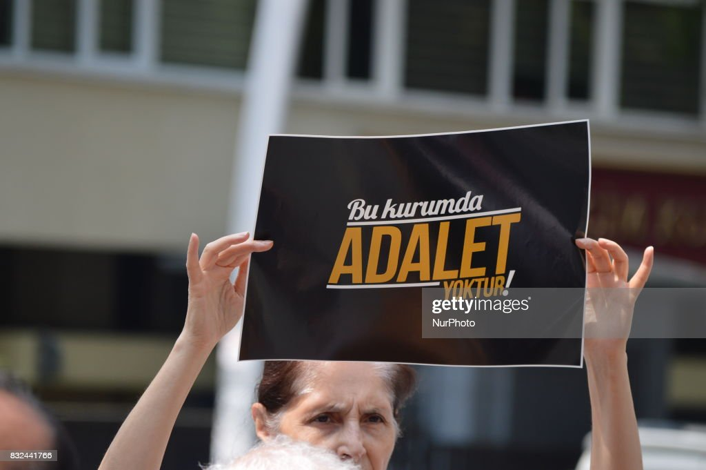 A woman holds a placard that reads 'There is no justice in this council' as anti-government demonstrators gathered in front of the Supreme Election Council (YSK) to protest against unsealed ballot papers in the voting for the Turkish constitutional referendum in Ankara, Turkey on August 16, 2017. The referendum was held on April 16 as the demonstrators chant the slogan 'We still search for justice' in the fourth month after historic voting.