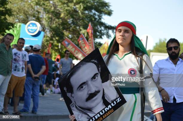 Woman holds a portrait during a march to the 24th anniversary of the Sivas massacre in Ankara on July 02, 2017. In 1993, 35 people were killed after...