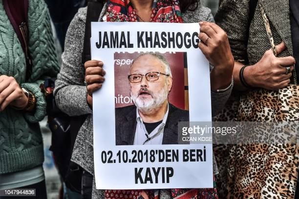 A woman holds a portrait of missing journalist and Riyadh critic Jamal Khashoggi reading Jamal Khashoggi is missing since October 2 during a...