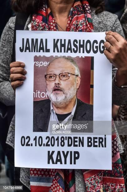 A woman holds a portrait of missing journalist and Riyadh critic Jamal Khashoggi reading Jamal Khashoggi is missing since October 2 during a...