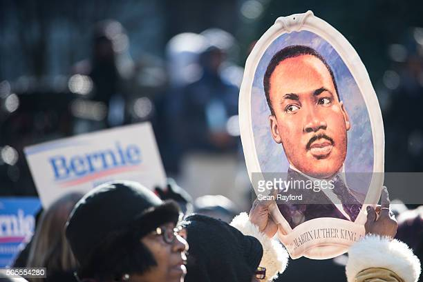 woman holds a portrait of Rev Dr Martin Luther King during the King Day at the Dome rally at the SC State House January 18 2016 in Columbia South...