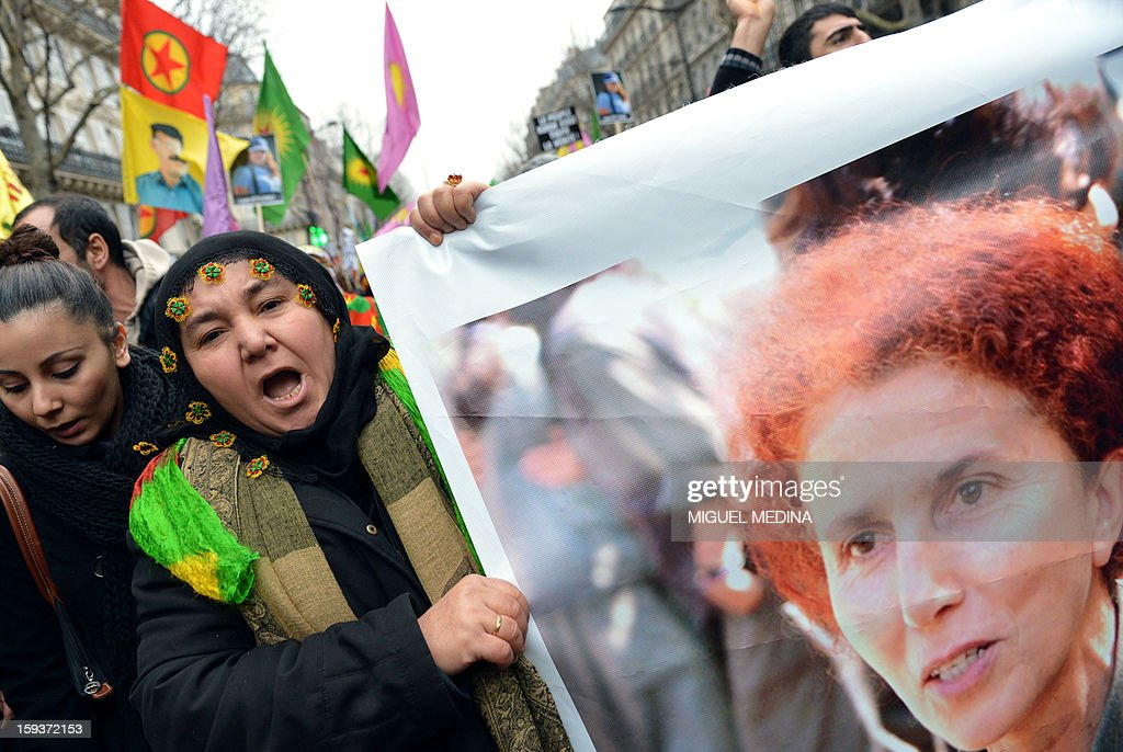 A woman holds a poster of Sakine Cansiz, a founding member of the militant Kurdistan Workers Party (PKK), as she takes part in a demonstration on January 12, 2013 in Paris, two days after three Kurdish women were found shot dead at Paris Kurdistan Information Bureau. Thousands of Kurds from all over Europe are expected in Paris today for what is expected to be an angry protest over the killing of three female activists shot dead at least three times in the head, giving further credence to the theory of an execution-style hit. Kurdish activists have accused Turkey or rogue nationalist elements in the country's military of being behind the killings.