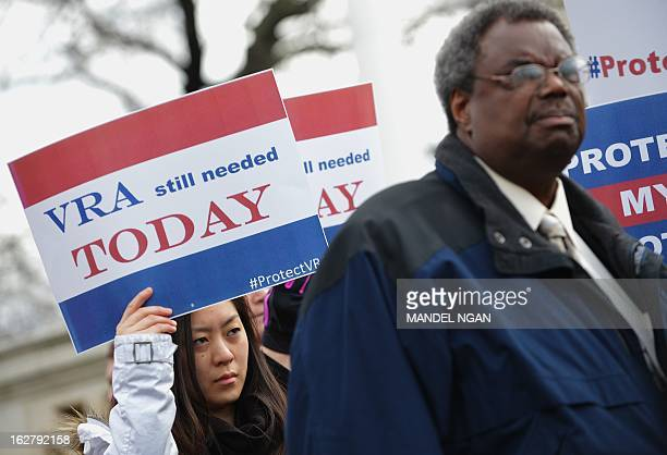 A woman holds a provoting rights placards during a rally outside of the US Supreme Court on February 27 2013 on Capitol Hill in Washington DC as the...