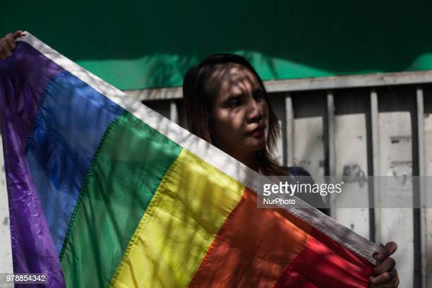 Unidentified LGBT advocates pose for a photo during a rally for marriage equality at the Supreme Court in Manila Philippines on Tuesday 19 June 2018...