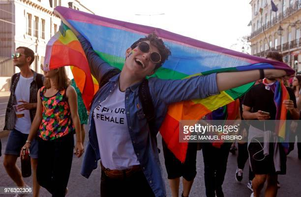A woman holds a rainbow flag during the Lesbian Gay Bisexual Transsexual Transgender Intersex Pride parade in Lisbon on June 16 2018