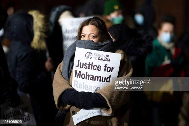 Woman holds a sign during a candlelight vigil outside Cardiff Bay police station on February 9, 2021 in Cardiff, Wales. Mohamud Mohammed Hassan was...