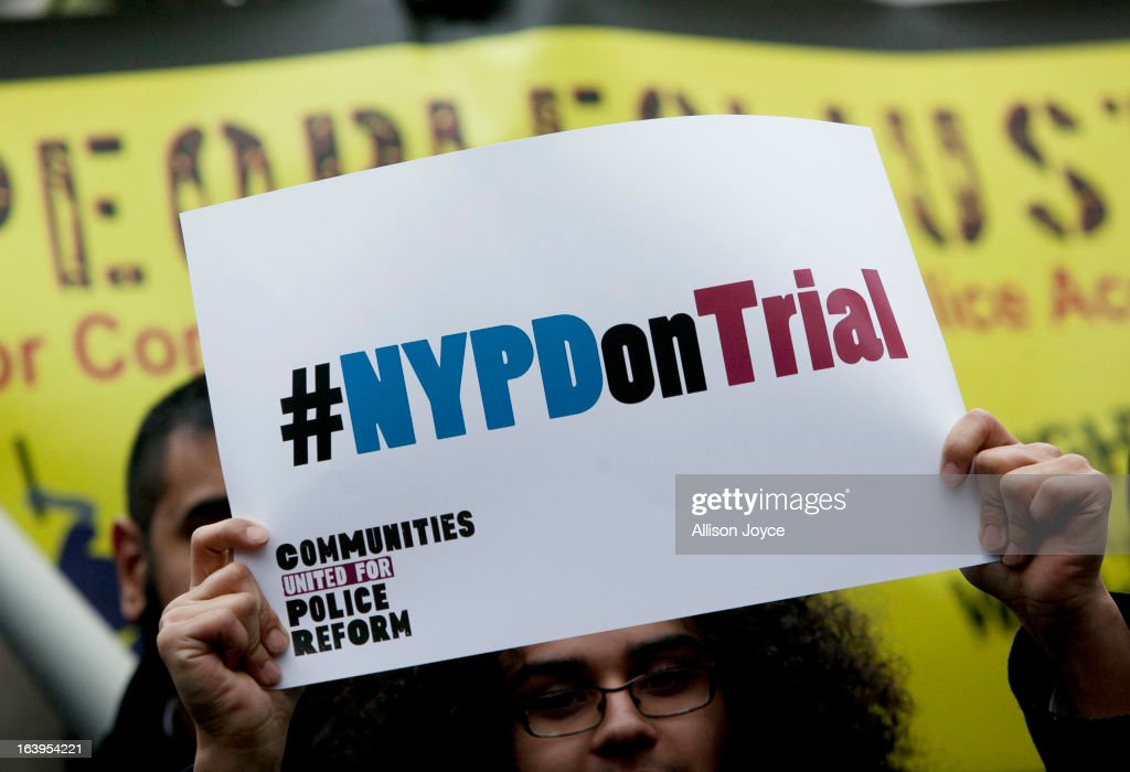 A woman holds a sign during a demonstration against the city's 'stop and frisk' searches in lower Manhattan near Federal Court March 18, 2013 in New York City. Hearings in a federal lawsuit filed by four black men against the city police department's 'stop and frisk' searches starts today in Manhattan Federal Court.