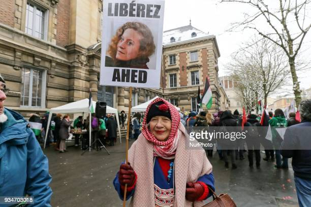 A woman holds a sign during a demonstration on March 19 in front of the court of Versailles near Paris in support of French political activist Olivia...