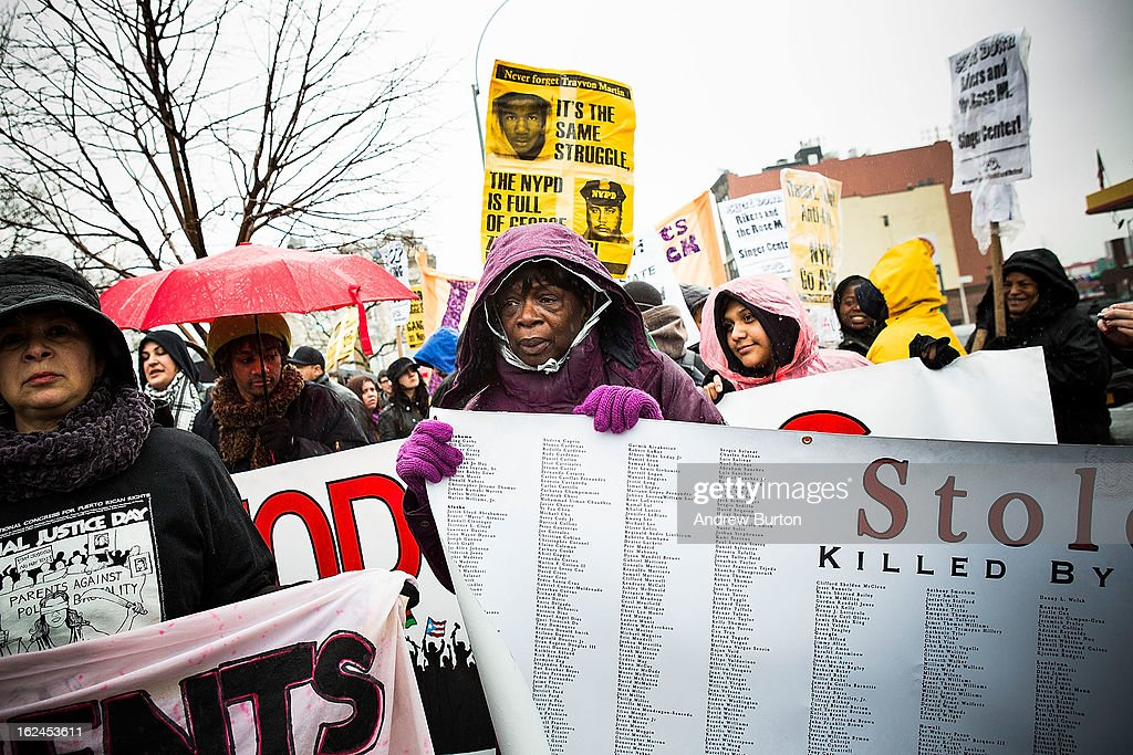 A woman holds a sign during a march against police stop-and-frisk tactics on February 23, 2013 in New York City. The march, which consisted of a few hundred people, started in the Bronx borough of New York and marched into the Harlem neighborhood of Manhattan.