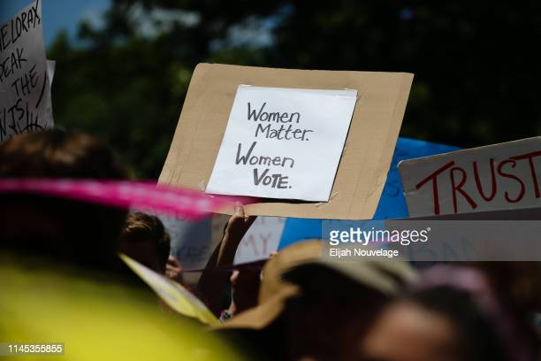 A woman holds a sign during a protest against recently passed abortion ban bills at the Georgia State Capitol building on May 21 2019 in Atlanta...
