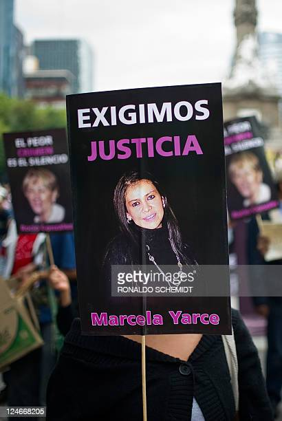 A woman holds a sign during a protest against violence towards journalists in Mexico on September 11 in Mexico City More than 60 journalists have...